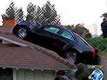 Американец  припарковал свой Cadillac на крышу  (видео)